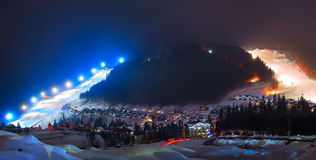Ski resort at night. Winter ski resort at night in the mountains Royalty Free Stock Photos