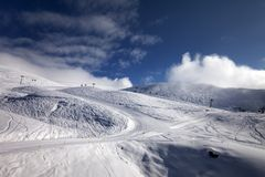 Ski resort with off-piste and ratrac slope. Royalty Free Stock Photography