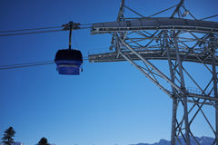 Ski resort panorama with cable car lift cabin. Snow mountain Stock Image