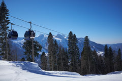 Ski resort panorama with cable car lift cabin. Snow mountain Royalty Free Stock Image