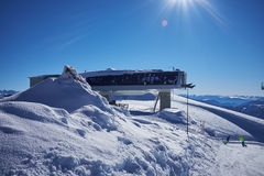 Ski resort panorama with cable car lift cabin. Snow mountain Royalty Free Stock Photo