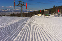 Ski resort ready for open. Freshly grooved ski slope ready Stock Image