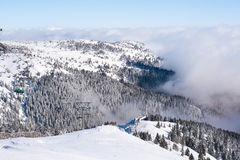 Ski resort, ski lift, mountain view, fog Royalty Free Stock Photography