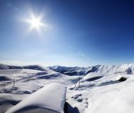 Ski resort and sky with sun Stock Photography