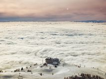 Skiing above fog Stock Photos