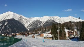 Ski resort, snow-capped mountains, ski slopes, cottage village, Krasnaya Polyana, Russia Stock Images