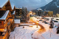 Ski resort. Snow covered streets and chalets in a French ski resort after sunset stock photos