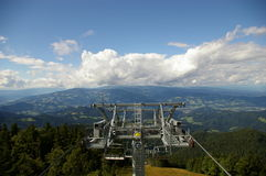 Ski resort during summer. The view from ski resort Kope, which is located on Pohorje, Slovenia. The photo is taken in the direction of Slovenj Gradec. Cable car Royalty Free Stock Images