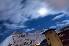 Ski resort Tignes. Winter Ski resort Tignes by night. Clouds and star in the long exposure Stock Photos