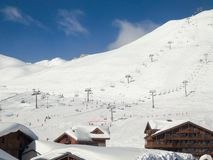 Ski resort of Tignes in winter, ski lifts and village of Tignes le lac. In the foreground stock photography