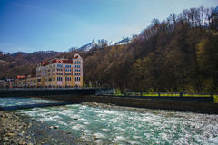 Ski resort in the Valley Rosa Khutor. Located on the shore of a mountain river in the valley Stock Images