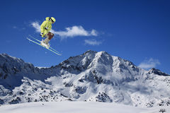 Ski rider jumping on mountains. Extreme freeride sport. Ski rider jumping on mountains. Extreme ski freeride sport Stock Images