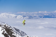 Ski rider jumping on mountains. Extreme freeride sport. Stock Images
