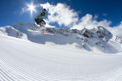 Ski rider jumping on mountains. Extreme freeride sport. Royalty Free Stock Photos