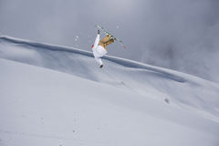 Ski rider jumping on mountains. Extreme ski freeride sport. Royalty Free Stock Photography