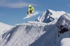 Ski rider jumping on mountains. Extreme ski freeride sport. Stock Image