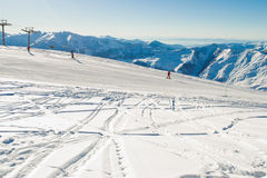 Ski run with amazing view on Caucasus Mountain range. Skiing resort. Extreme sport. Active holiday. Free time, travel concept. Cop Stock Images