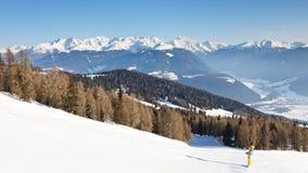 Ski Run and Snow Covered Alpine Peaks Royalty Free Stock Photo