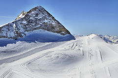 Ski runs on slopes of Hintertux Glacier. Hintertux Glacier in Tux Alps in Austria with ski runs, pistes and ski lifts stock photos