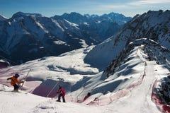 Ski sceninc image in Swiss Alps. Children sking in the Swiss Alps. View from Eggishorn ski slopes, Fiescheralp, Fiesch Wallis-Valais Switzerland stock image