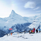 Ski school. Ski instructor and kids at ski school, in Swiss Alps. Matterhorn in the background Stock Photos