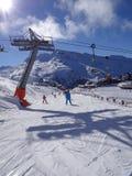 Ski school descends the piste Royalty Free Stock Image