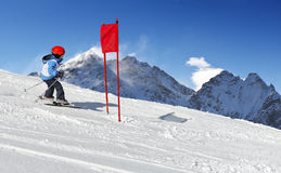 Ski School Slalom. Young child during his ski school slalom run Stock Photo
