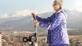 Ski season in the Mountains. Attractive Girl with Snowboard.  stock video footage