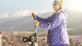 Ski season in the Mountains. Attractive Girl with Snowboard .  stock video footage