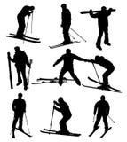 Ski silhouettes Royalty Free Stock Image