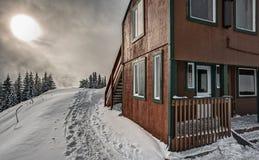 Alpine Snow Hut Illuminated by Sun Stock Photography