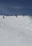 Ski Slope. Skiers at the top of a slope royalty free stock photo