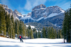 Ski slope. Skier going down the slope at Val Di Fassa ski area in Italy Stock Photography