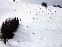Ski slope. Skiers on downhill slope Royalty Free Stock Photo