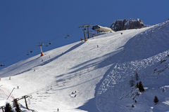 Ski slope in Alpine mountains Royalty Free Stock Images
