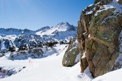 Ski slope in Alps. The boulder in winter snow mountains, ski slope in Alps, Andorra Stock Images