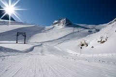 Ski slope in alps mountains Stock Photo