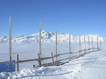 Ski slope in altitude with views of mountain peaks. On the Alps Royalty Free Stock Image