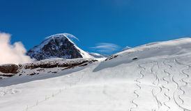 Ski slope in the background of Mount Eiger. Stock Images