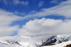 Ski slope and blue sky with clouds Royalty Free Stock Images