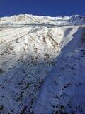 Ski slope and blue sky. Georgia, ski resort Gudauri. Caucasus Mountains royalty free stock photo