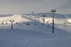 Ski slope with chair-lift in evening Royalty Free Stock Photo