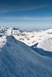 Ski slope in Chamonix mountains. Ski slope in Chamonix. Skiing area in French Alps among snowbound mountain peaks Royalty Free Stock Photography
