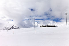 Ski slope in cloudy sunny day Royalty Free Stock Image