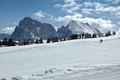 Ski slope, Dolomites - Italy. Winter sports, skier on a ski slope royalty free stock image