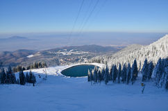 Ski slope at high altitude, and a lake, winter landscape Royalty Free Stock Photography