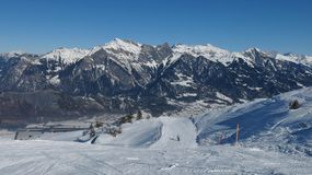 Ski slope and high mountains Royalty Free Stock Photo