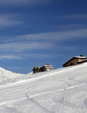 Ski slope and hotels in winter mountains Stock Photos