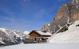 Ski slope and hut in Dolomites, Italy Royalty Free Stock Images
