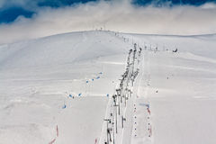 Ski slope with a lift Royalty Free Stock Photography